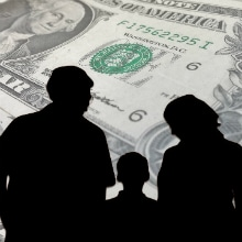 silhouette of people looking at money