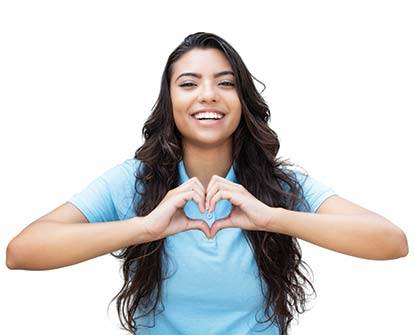 girl showing a heart symbol
