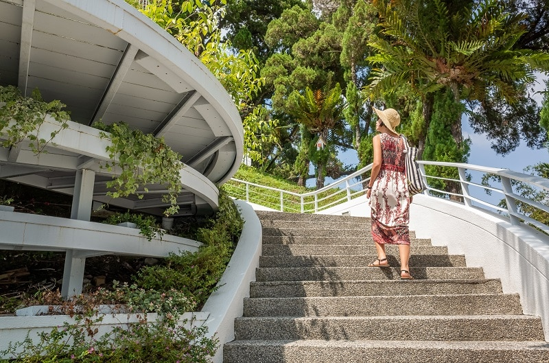 Woman walking at a stairs.