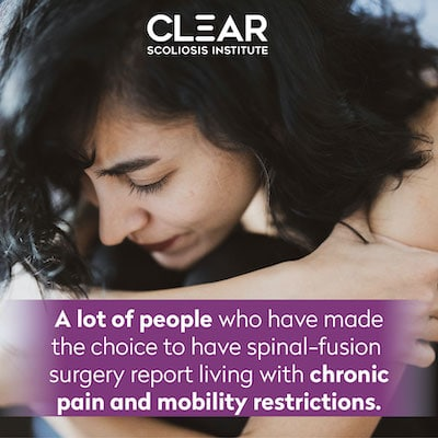 Woman in pain from spinal fusion